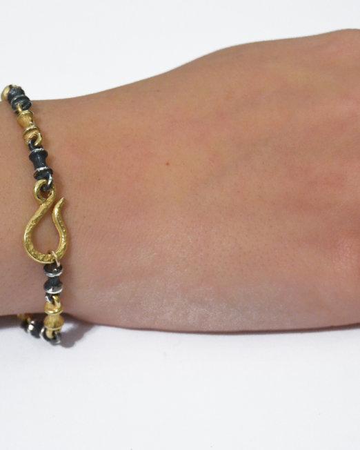 bracciale osso oro e argento